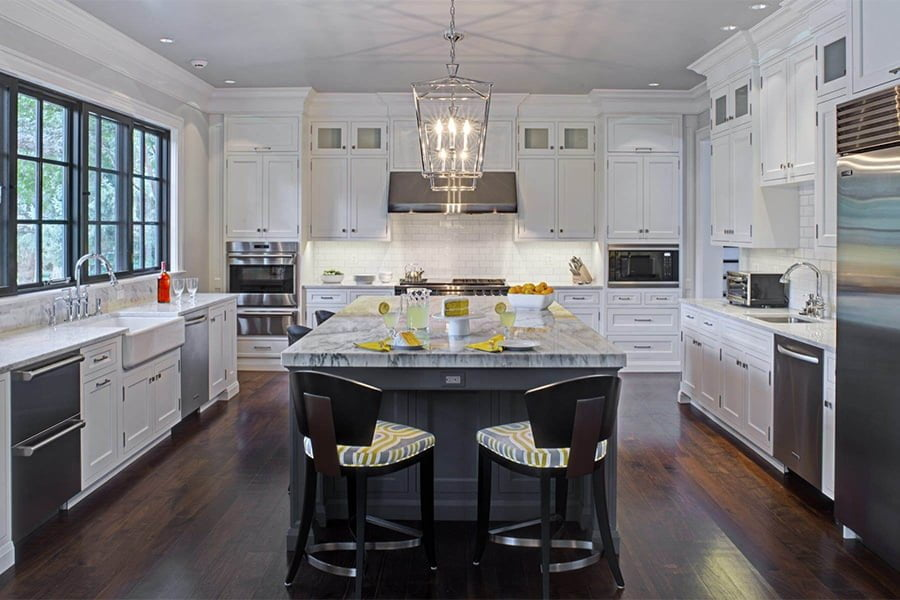 Transitional/modern kitchen with custom white cabinetry, granite countertops, stainless steel appliances, dark hardwood flooring and grey island cabinetry