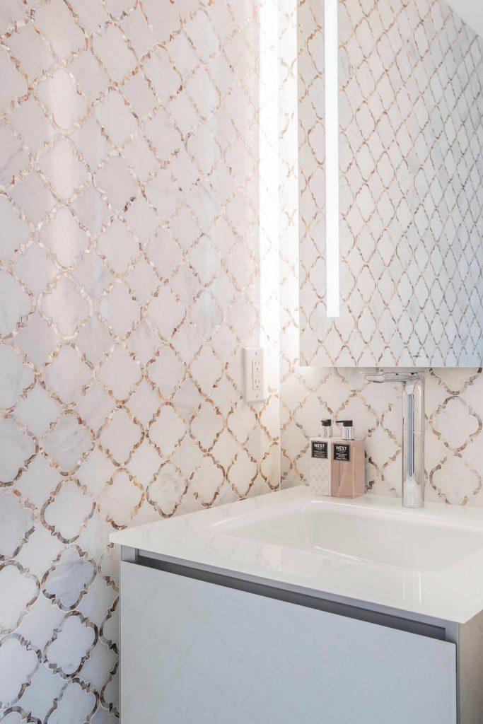 Decorative tile work on wall and backsplash