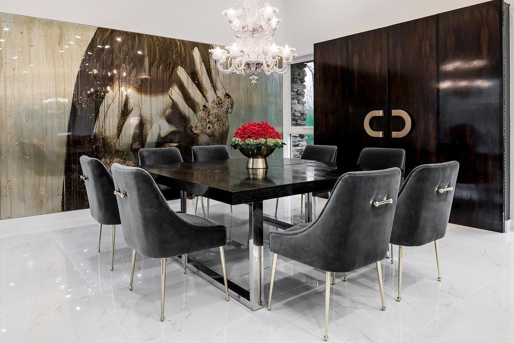 Very high end dining room set with suede chairs, metal snd black wood dining table, white marble flooring (different angle)