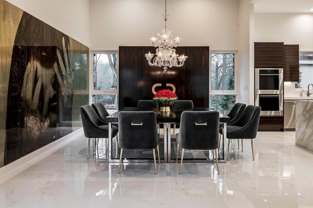 Very high end dining room set with suede chairs, metal and black wood dining table, white marble flooring