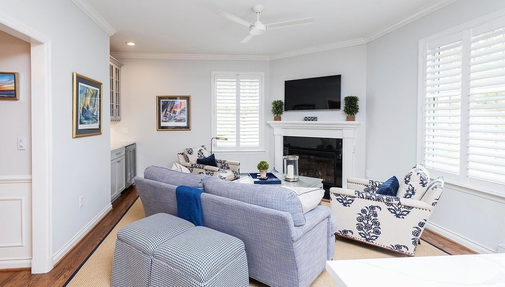 Transitional family room and mini bar with blue overtones and custom cabinetry (back angle)
