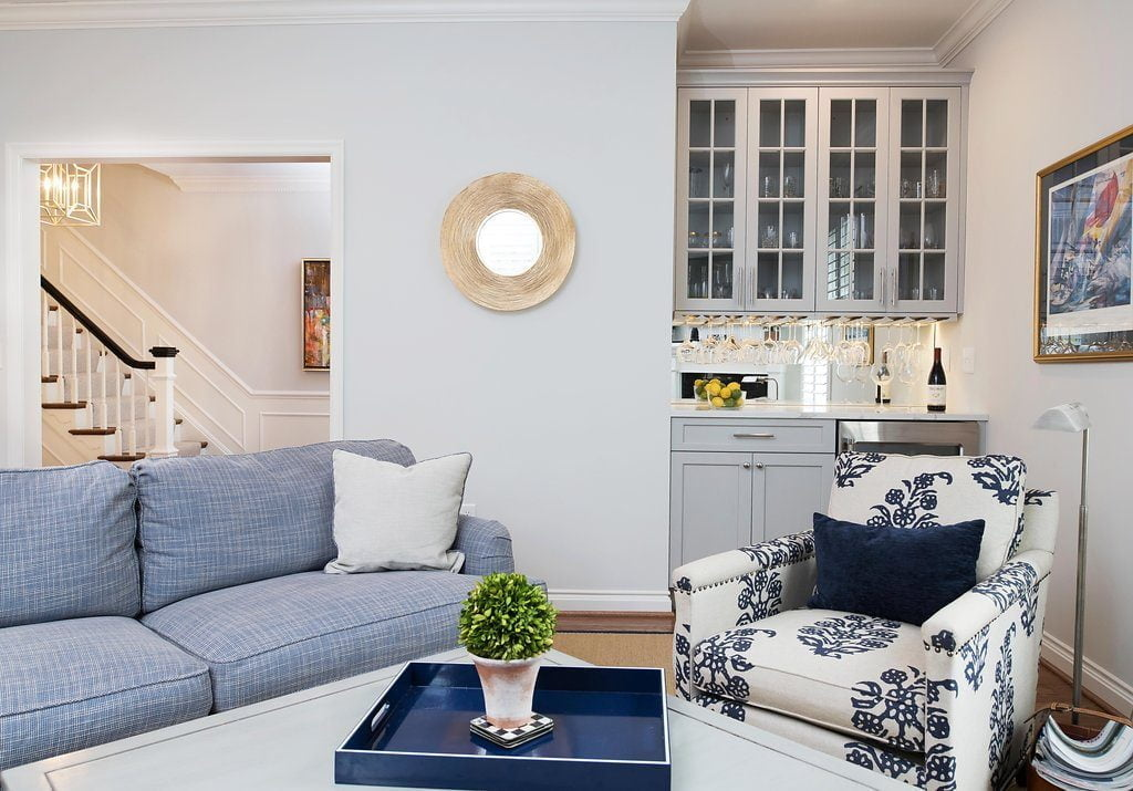 Transitional family room and mini bar with blue overtones and custom cabinetry