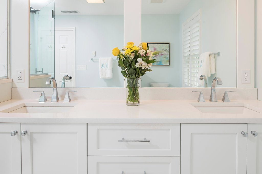 High end bathroom sinks with white cabinetry and marble countertops