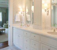 Transitional bathroom with white cabinetry, white marble countertops, and light grey tile flooring