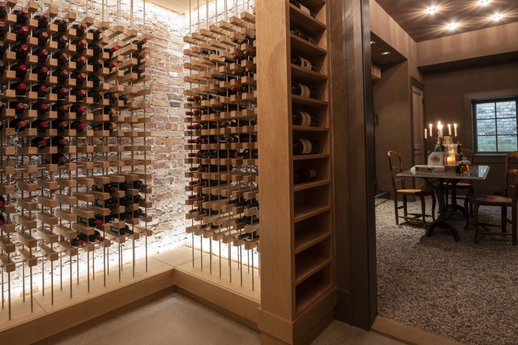 Custom wine cellar completed by Sunnyfields Cabinetry and Delbert Adams Construction Group, both Baltimore luxury home designers.