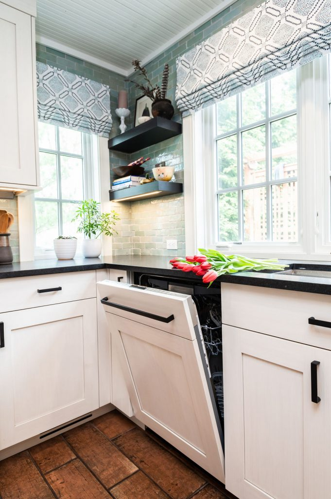 Transitional kitchen counter with dishwasher access