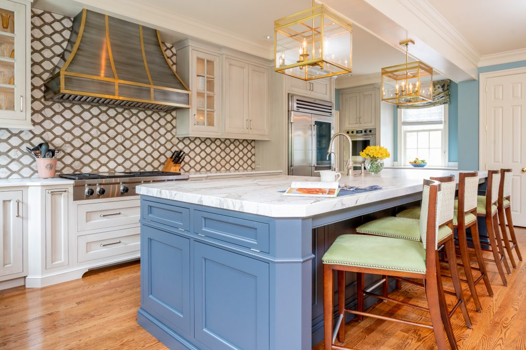 Transitional full kitchen with custom white cabinetry and blue accent marble island