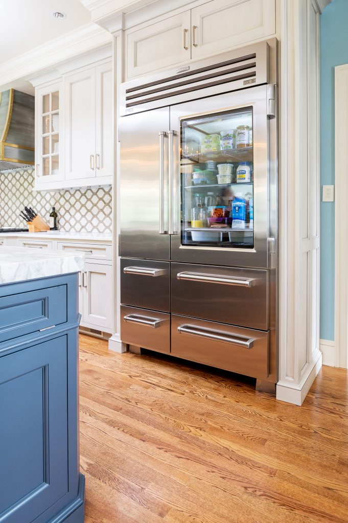 Stainless steel custom refrigerator in transitional kitchen with blue accent