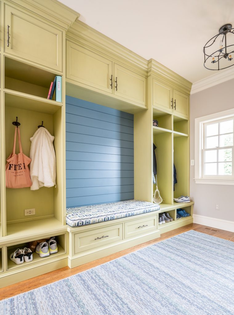 Transitional yellow mudroom cubbies with blue backsplash bench