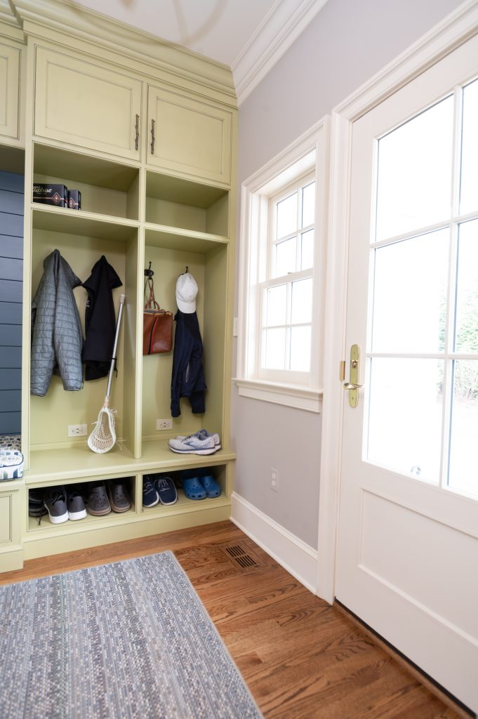 Yellow clothing storage cubby unit holding accessories