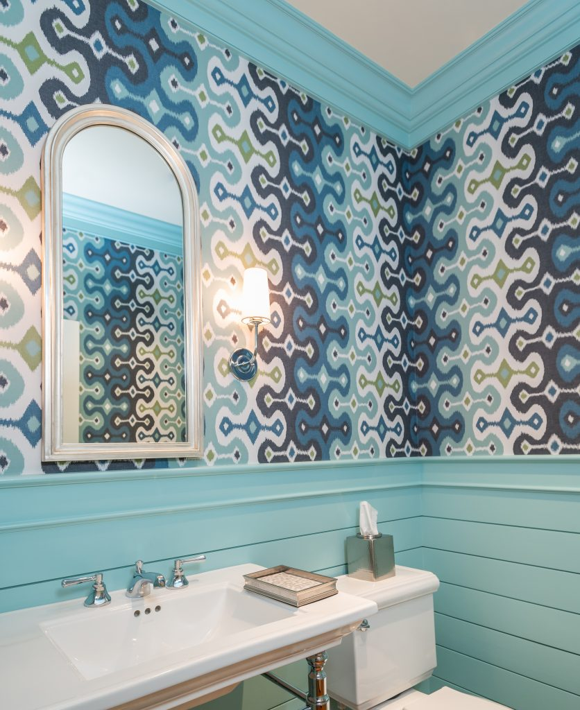 Transitional bathroom with blue patterned wallpaper