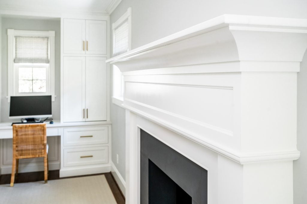 Transitional white crown molding above fireplace