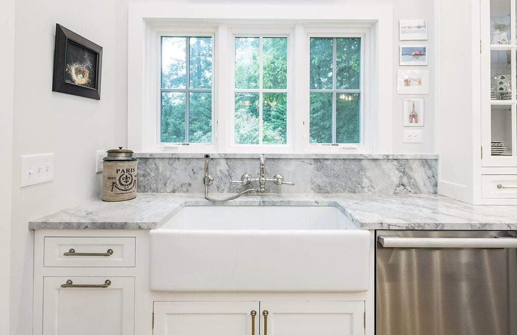 Transitional white cabinet kitchen sink with granite countertop and stainless steel faucet