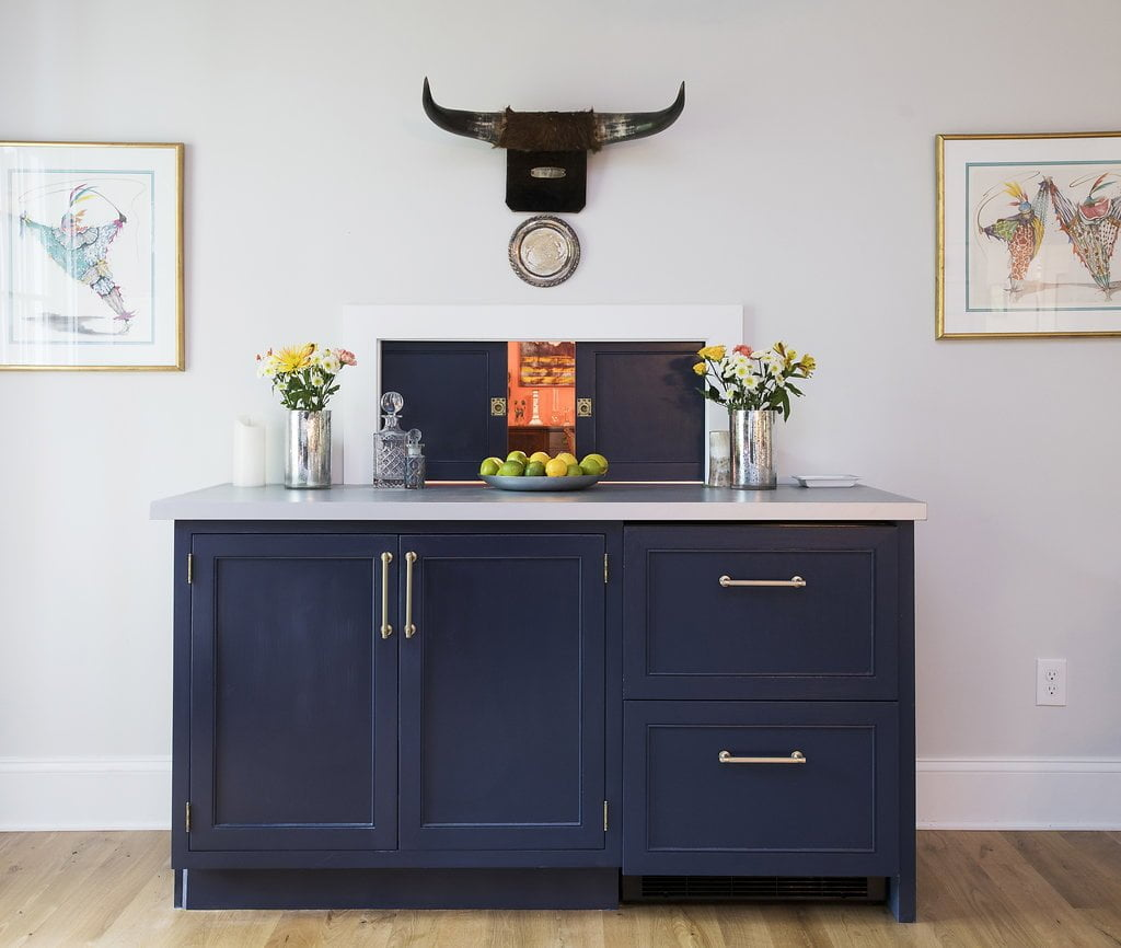 Transitional custom navy cabinetry and light grey walls