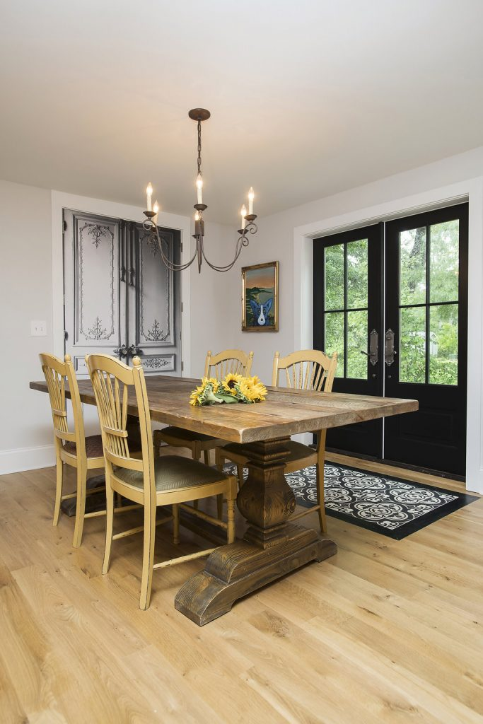 Rustic dining room set with black exterior backdoors