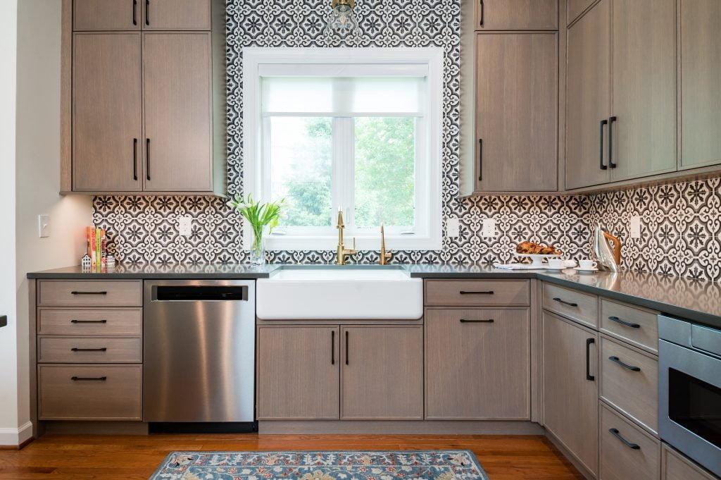 Patterned tile backsplash and custom white and gold sink and faucet (zoomed out)