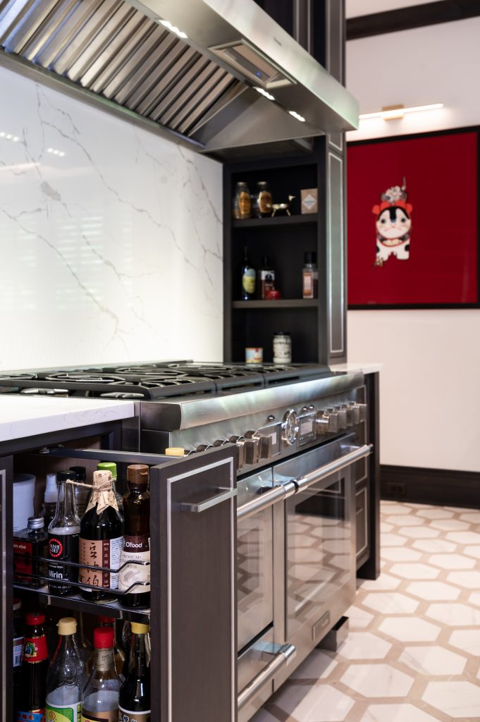 Modern appliance counter with stainless steel ovens and hood vent (zoomed in) (open cabinet)