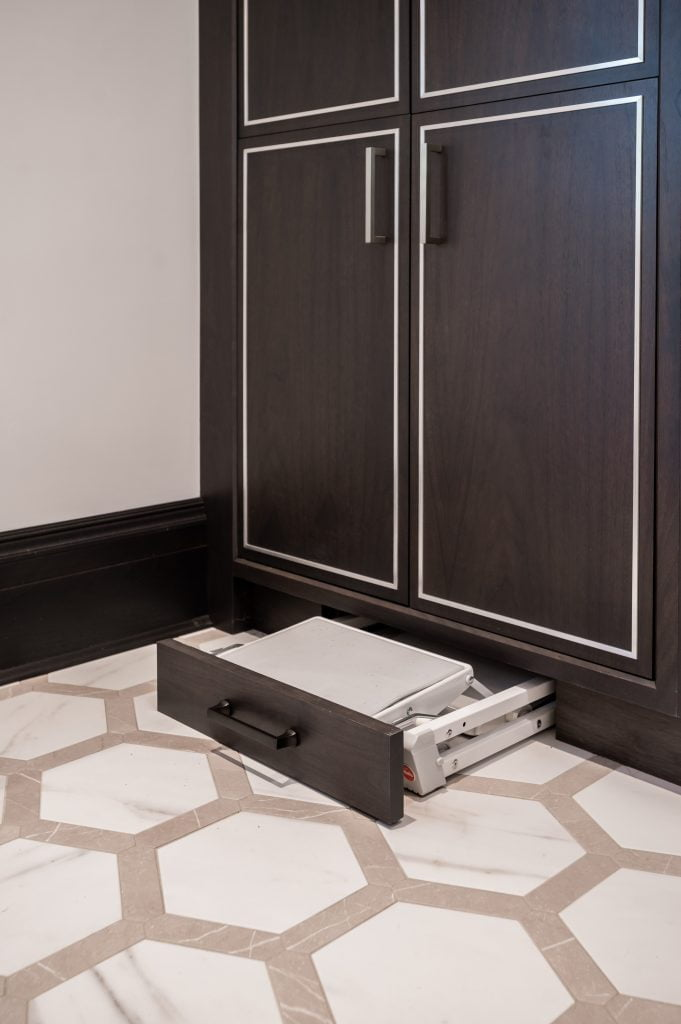 Custom pull-out/folding stool in custom cabinetry