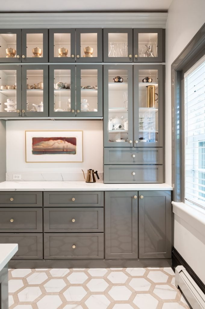 Custom grey floor-to-ceiling cabinetry and marble countertops (zoomed out) (different angle)