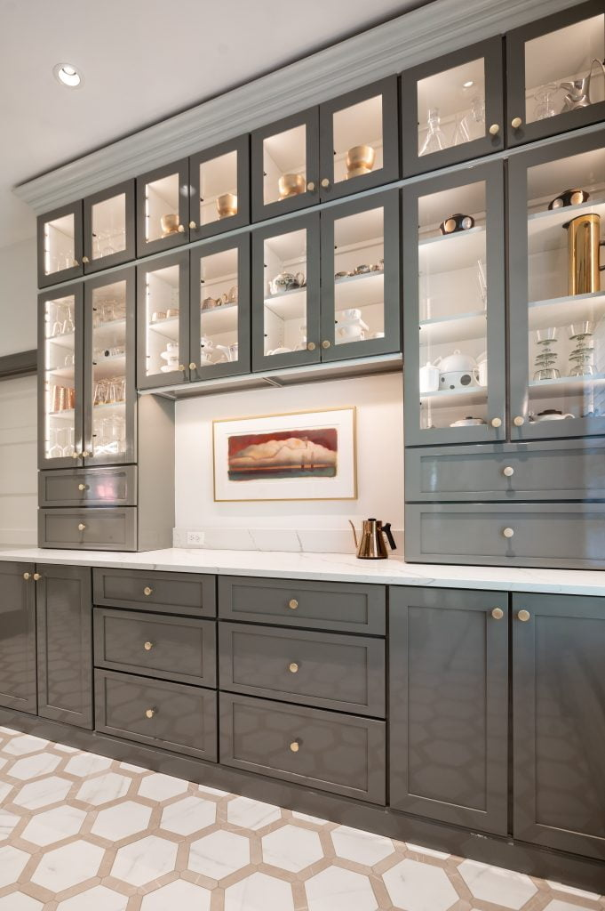 Custom grey floor-to-ceiling cabinetry and marble countertops (zoomed out)